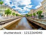 houses along vridelni riverside ... | Shutterstock . vector #1212264040
