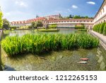 a pond with the hercules'... | Shutterstock . vector #1212265153