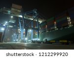 container ship in port at... | Shutterstock . vector #1212299920
