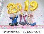 three friends enjoying party ... | Shutterstock . vector #1212307276