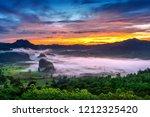sunrise on the morning mist at... | Shutterstock . vector #1212325420