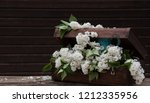 white lilac and wooden... | Shutterstock . vector #1212335956