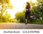 woman running on street outdoor | Shutterstock . vector #1212350986