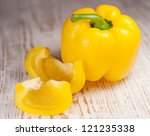 Yellow Bell Pepper On A Wooden...
