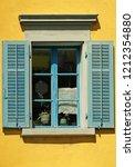 window with green shutters on...   Shutterstock . vector #1212354880