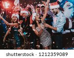 happy young people dancing on... | Shutterstock . vector #1212359089