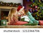 happy little sisters wearing...   Shutterstock . vector #1212366706