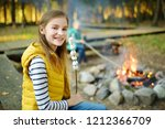cute preteen girl roasting... | Shutterstock . vector #1212366709