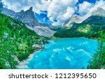 sorapiss lake in italian alps ... | Shutterstock . vector #1212395650
