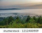 long shot foggy sunrise in the... | Shutterstock . vector #1212400909
