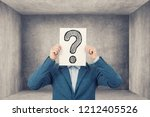 perplexed young student... | Shutterstock . vector #1212405526
