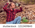 lumberjack with chainsaw and... | Shutterstock . vector #1212409843