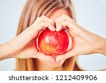 healthy apple and fruit once a... | Shutterstock . vector #1212409906