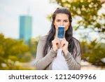 cute young woman using...   Shutterstock . vector #1212409966