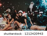 three young women celebrating... | Shutterstock . vector #1212420943