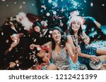 two young women celebrating new ... | Shutterstock . vector #1212421399