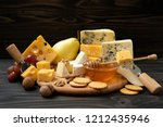 delicious cheese on the table.... | Shutterstock . vector #1212435946