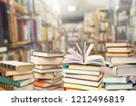 old books on dark  background | Shutterstock . vector #1212496819
