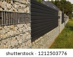 a fragment of a long fence of a ... | Shutterstock . vector #1212503776