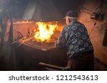 Old Blacksmith Burning Coal....