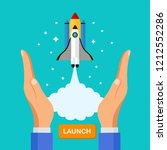 rocket in hands isolated on... | Shutterstock .eps vector #1212552286