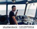 marine navigational officer is... | Shutterstock . vector #1212573316