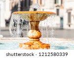 rome  italy closeup of fountain ... | Shutterstock . vector #1212580339