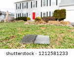 front yard of house during day... | Shutterstock . vector #1212581233