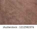 a piece of brown suede. texture ... | Shutterstock . vector #1212582376