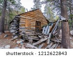 The ruins of an old wooden cabin in the woods of Eastern Sierra mountains, California