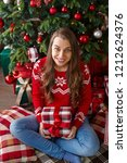 a smiling woman in a red... | Shutterstock . vector #1212624376