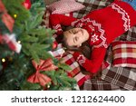 young cute smiling girl in red... | Shutterstock . vector #1212624400