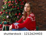 happy young woman sitting near... | Shutterstock . vector #1212624403