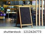 restaurant sidewalk chalkboard... | Shutterstock . vector #1212626773