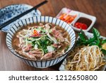Vietnamese Phở Beef Noodle Soup Bowl with vegetable