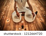 young man playing crystal bowls ... | Shutterstock . vector #1212664720
