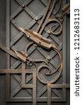 wrought iron gates  ornamental... | Shutterstock . vector #1212683113