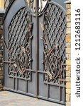 wrought iron gates  ornamental... | Shutterstock . vector #1212683116