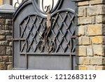 wrought iron gates  ornamental... | Shutterstock . vector #1212683119