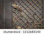wrought iron gates  ornamental... | Shutterstock . vector #1212683140