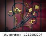 wrought iron gates  ornamental... | Shutterstock . vector #1212683209
