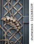 wrought iron gates  ornamental... | Shutterstock . vector #1212683239