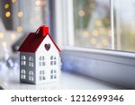 toy house with hole in form of... | Shutterstock . vector #1212699346