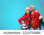young couple in christmas... | Shutterstock . vector #1212713680