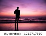 Silhouette Of A Photographer A...