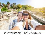 two beautiful happy young women ... | Shutterstock . vector #1212733309