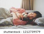 image of an asian woman...   Shutterstock . vector #1212739579