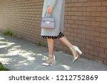 fashionable young woman wearing ... | Shutterstock . vector #1212752869
