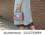 fashionable young woman wearing ... | Shutterstock . vector #1212752899