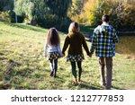 familiy in similar cloth... | Shutterstock . vector #1212777853